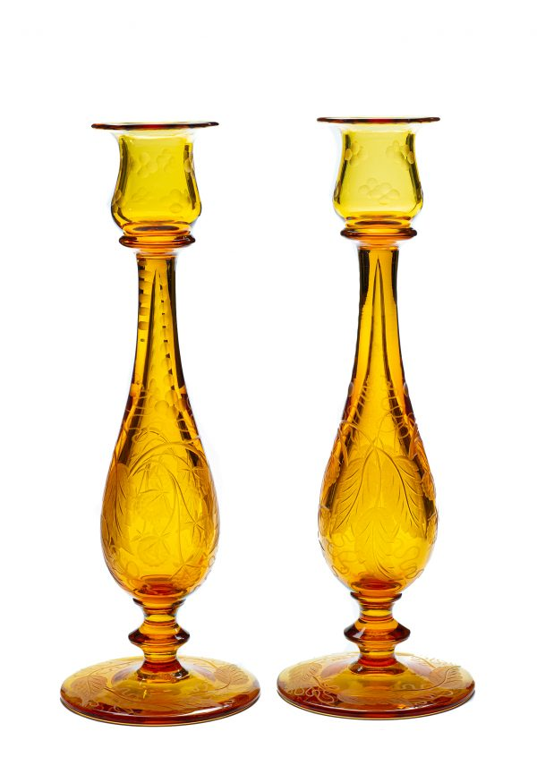 A pair of amber candlesticks in the blackberry pattern