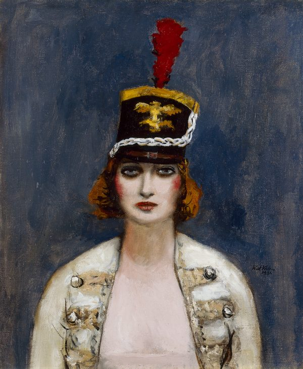 A shako is the military dress hat seen in this portrait of a female circus performer.