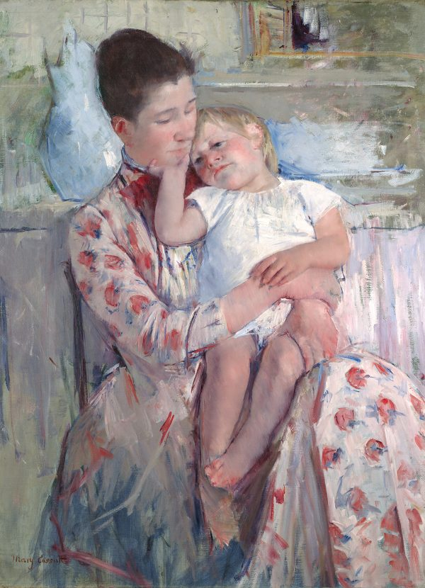A woman in a flowered dress holds a child. There is a blue vase and wash basin behind her.