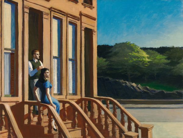 A couple look into the distance from their brownstone staircase.