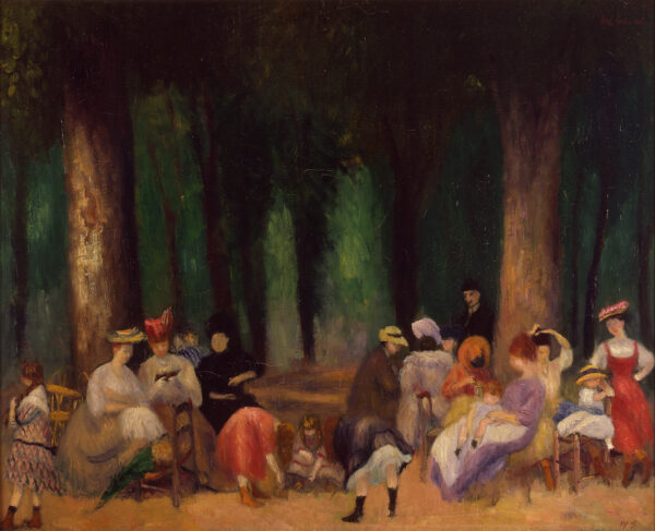 Women gather in a park, standing and sitting in front of a green woods behind them.