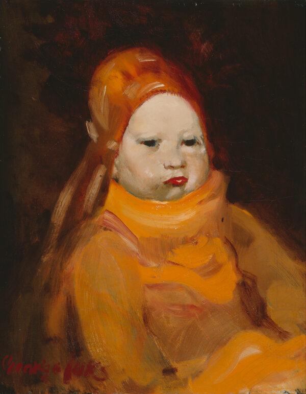 A baby wears an orange sweater and hat.