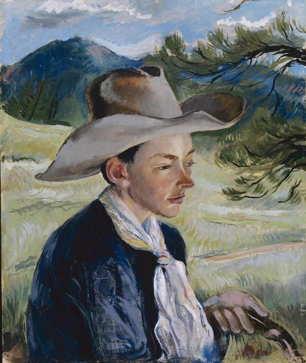 Portrait of a young man wears a cowboy hat and is holding reins in his left hand. There is a landscape behind him of a pine tree on the right and a mountain on the left.