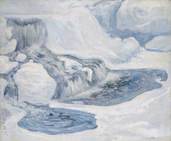Close-up view of a waterfall in winter. The blue water is surrounded by white ice.