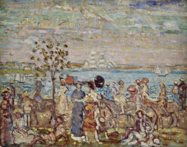 A scene of a crowd in a park with water and boats in the background.