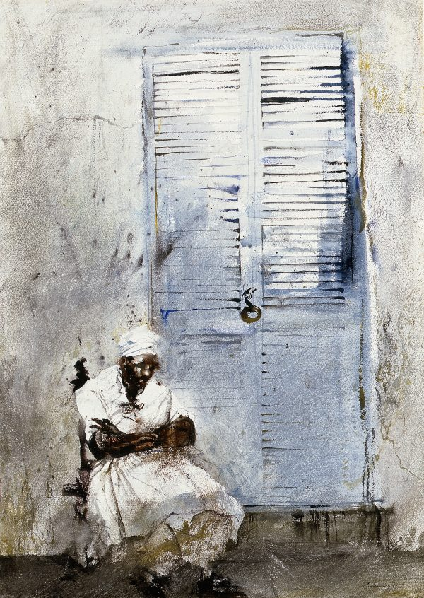 A woman in a white dress and kerchief sits in front of a door with slats.
