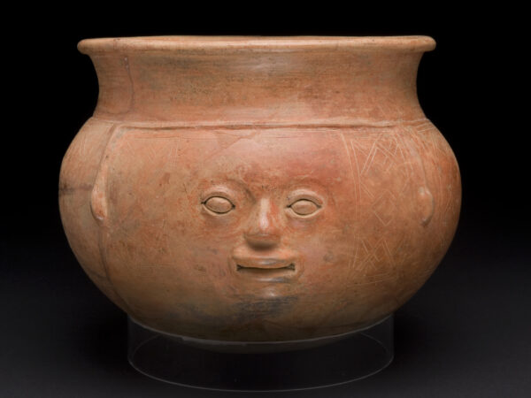 Terra cotta orangish-brown bowl with a human face sculpted on the front