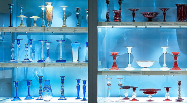 Interview view of display case filled with glass works