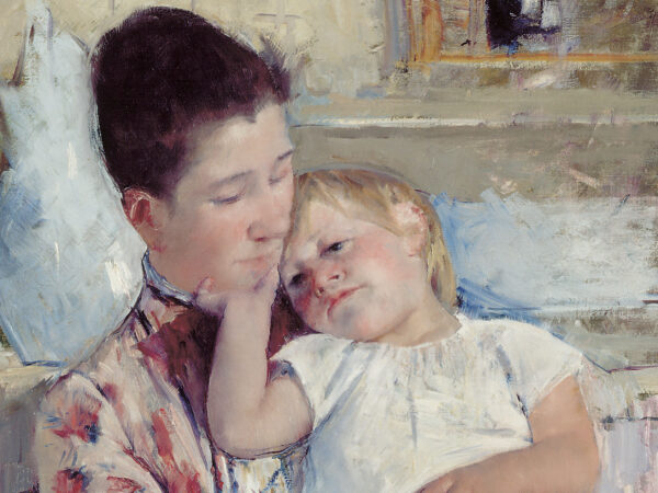 A woman in a flowered dress holds a child. There is a blue vase and washbasin behind them in this painting by Mary Cassatt