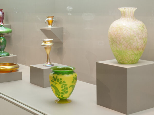 Gallery image of Steuben glass - green and yellow vase in the foreground