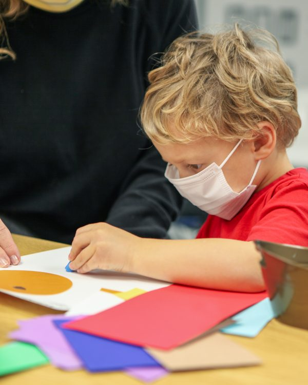 Interior view of a young boy making art
