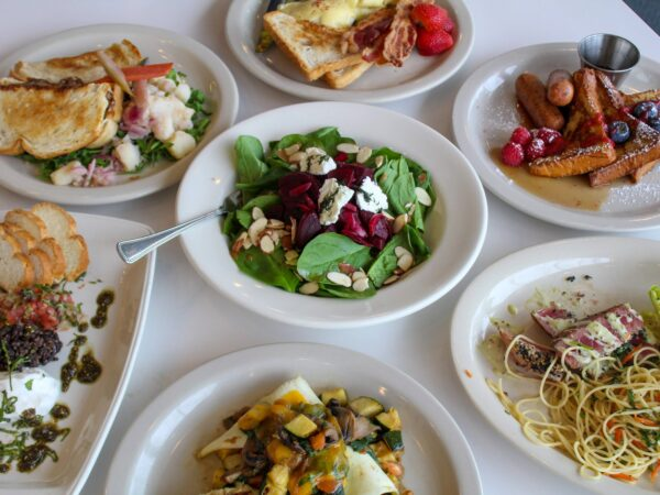 Overhead photo of plates of food from the Muse Cafe