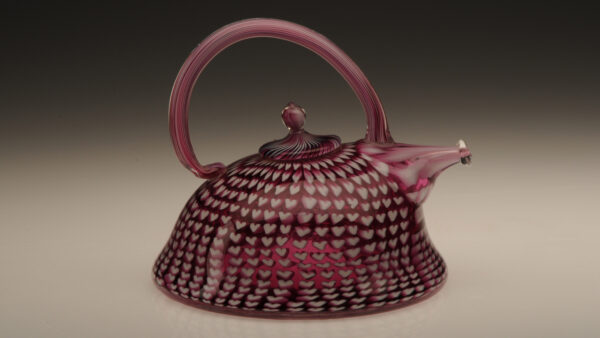 White and raspberry colored fused glass teapot by artist Richard Marquis