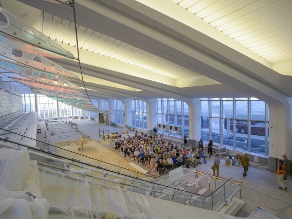 Interior view of the new Wichita Eisenhower Airport terminal with members of the Murdock Society seated in chairs waiting for artist Ed Carpenter to speak