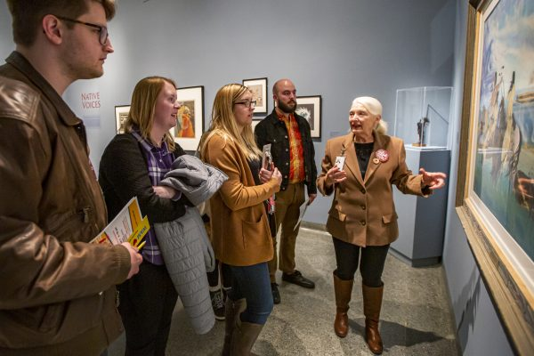 Interior view of a group of teachers and educators looking at art with a WAM docent