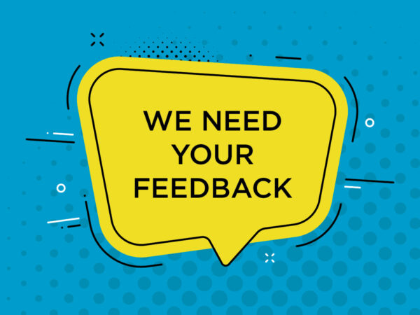 Light blue graphic with grey circles on it and a yellow word bubble with We Need Your Feedback in a black sans-serif font