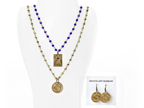 Photo of gold necklaces and earrings with the Wichita flag