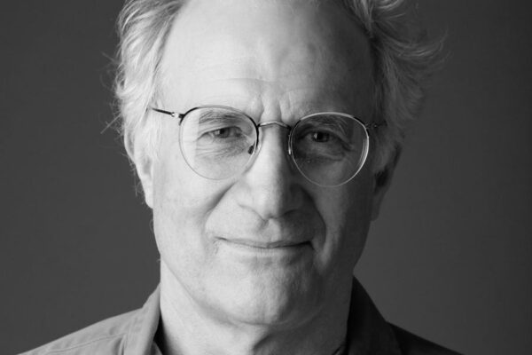 Black and white photo of a man's face with glasses