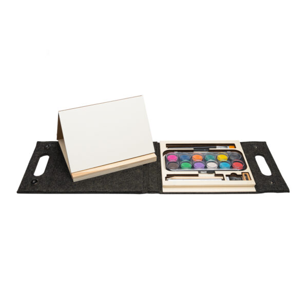 Watercolor kit with 12 paints on the right and a small easel on the left with a black carrying case