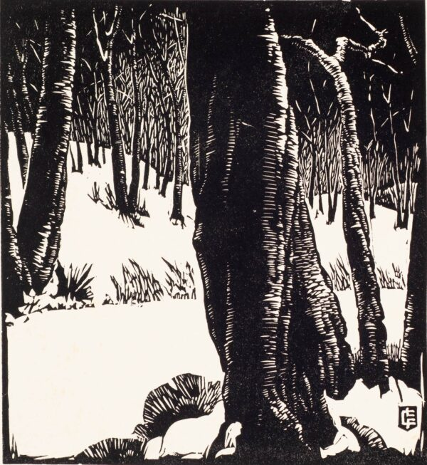 Black and white block print of tree trunks on a snow-covered hillside