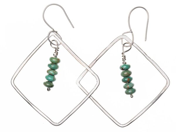 Silver diamond-shaped dangle earrings with four turquoise beads suspended on wire in the middle. Earrings are suspended on French hooks for pierced ears.